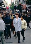 Crowd of people walking down a street, blurred. Stock Photo - Premium Royalty-Free, Artist: Garry Black, Code: 696-03397033