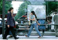 People walking past bus stop, blurred. Stock Photo - Premium Royalty-Freenull, Code: 696-03397334