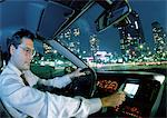 Man in car in city at night Stock Photo - Premium Royalty-Free, Artist: Robert Harding Images, Code: 696-03397961
