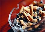 Ashtray full of cigarette butts Stock Photo - Premium Royalty-Freenull, Code: 696-03397983