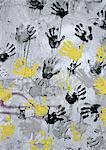 Yellow, black, gray hand print on wall Stock Photo - Premium Royalty-Free, Artist: Aurora Photos, Code: 696-03398208
