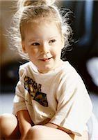 Little girl sitting Stock Photo - Premium Royalty-Freenull, Code: 696-03398649