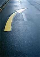 right - Directional arrow on road, close-up Stock Photo - Premium Royalty-Freenull, Code: 696-03398839