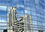 Building reflected in window panes Stock Photo - Premium Royalty-Freenull, Code: 696-03399103