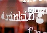 Relaxed, drinking text on window, close-up Stock Photo - Premium Royalty-Free, Artist: Daryl Benson, Code: 696-03399149