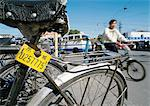 China, Beijing, close-up of old bicycle, man riding by on bicycle in background, blurred Stock Photo - Premium Royalty-Free, Artist: Raimund Linke            , Code: 696-03399227