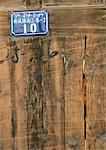 China, close-up of old wooden door bearing shiny new address plate Stock Photo - Premium Royalty-Free, Artist: Masterfile, Code: 696-03399283