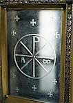 Christian monogram engraved in metal