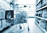 Shopping cart in aisle of supermarket, blurred Stock Photo - Premium Royalty-Free, Artist: Blend Images, Code: 696-03399955