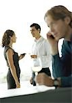 Cocktail party, focus on man and woman talking in background Stock Photo - Premium Royalty-Freenull, Code: 696-03400989