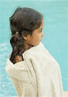 Girl wrapped in towel, water in background Stock Photo - Premium Royalty-Freenull, Code: 696-03401033