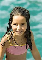 Girl in bathing suit, water in background, portrait Stock Photo - Premium Royalty-Freenull, Code: 696-03401034
