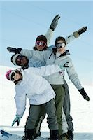 Young skiers standing on ski slope, full length portrait Stock Photo - Premium Royalty-Freenull, Code: 696-03401679
