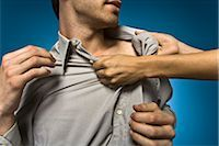 Woman grabbing man by shirt collar Stock Photo - Premium Royalty-Freenull, Code: 632-03403407