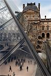musee de louvre courtyard with view into pyramid - paris
