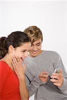 Teenage Girl and Boy with Cell Phone Stock Photo - Premium Royalty-Freenull, Code: 600-03403985