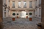 Sun Shining on Courtyard, Marais, Paris, France Stock Photo - Premium Rights-Managed, Artist: Damir Frkovic, Code: 700-03404636