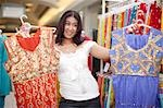 Woman looking at traditional Indian clothes, KwaZulu Natal Province, South Africa