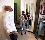 Man waiting for woman to finish trying on clothes, KwaZulu Natal Province, South Africa