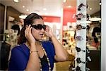 Woman trying on sunglasses, KwaZulu Natal Province, South Africa
