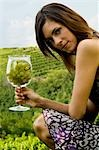 Young woman in vineyard with a wineglass of white grapes Stock Photo - Premium Royalty-Free, Artist: Aurora Photos, Code: 644-03405393