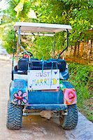 Golf cart with just married sign Stock Photo - Premium Royalty-Freenull, Code: 673-03405648