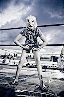girl in wrestling costume Stock Photo - Premium Royalty-Freenull, Code: 673-03405690