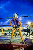 girl in wrestling costume Stock Photo - Premium Royalty-Freenull, Code: 673-03405691