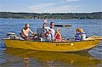 men and young children on motorboat ride Stock Photo - Premium Royalty-Free, Artist: Masterfile, Code: 673-03405797