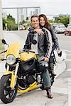 Portrait of Couple Sitting on Motorcycle Stock Photo - Premium Rights-Managed, Artist: Kevin Dodge, Code: 700-03406471