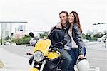 Portrait of Couple with Motorcycle Stock Photo - Premium Rights-Managed, Artist: Kevin Dodge, Code: 700-03406472