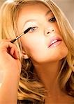 Close up of a young woman applying mascara Stock Photo - Premium Rights-Managed, Artist: ableimages, Code: 822-03406656