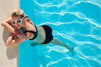 Elevated view of a woman at edge of swimming pool Stock Photo - Premium Rights-Managednull, Code: 822-03406876