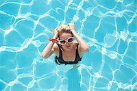 Elevated view of a woman standing in a swimming pool Stock Photo - Premium Rights-Managednull, Code: 822-03407024