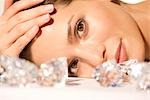 Close up of a young woman lying behind large diamonds Stock Photo - Premium Rights-Managed, Artist: ableimages, Code: 822-03407127