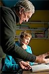 Grandfather showing grandson a drawing book Stock Photo - Premium Rights-Managed, Artist: ableimages, Code: 822-03407132