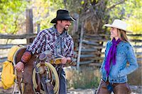 Cowboy Carrying Western Saddle and Talking with Cowgirl Stock Photo - Premium Rights-Managednull, Code: 700-03407357