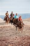 Group of Cowgirls and Cowboys Riding Horses through Badlands, Wyoming, USA Stock Photo - Premium Rights-Managed, Artist: F. Lukasseck, Code: 700-03407491