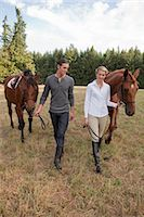 Couple with Horses, Brush Prairie, Washington, USA Stock Photo - Premium Rights-Managednull, Code: 700-03407775