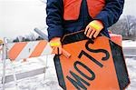 Construction Worker Holding Slow Sign Stock Photo - Premium Rights-Managed, Artist: Brian Kuhlmann, Code: 700-03408090