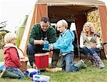 Family setting up camp Stock Photo - Premium Royalty-Free, Artist: iRepublic, Code: 649-03417594