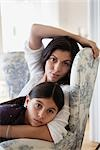 mother and daughter sitting in one chair Stock Photo - Premium Royalty-Freenull, Code: 649-03418657