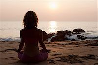 Woman practicing yoga on beach at sunset Stock Photo - Premium Royalty-Freenull, Code: 614-03420407