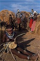 A Nyangatom girl weaves a grass basket. The Nyangatom or Bume are a Nilotic tribe of semi-nomadic pastoralists who live along the banks of the Omo River in south-western Ethiopia. Stock Photo - Premium Rights-Managednull, Code: 862-03437080