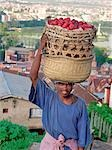 A plum seller in Antananarivo,the capital city of Madagascar and home to about 3 million people. The sprawling city is built on two ridges with the ruins of the Queen's Palace dominating the largest hill.