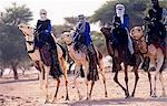 Niger,Timia Oasis. Tuareg riders preparing to race their camels as part of the Spring Harvest Festival. Stock Photo - Premium Rights-Managed, Artist: AWL Images, Code: 862-03437283