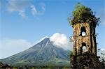 Philippines,Luzon Island,Bicol Province. Cagsawa Church Belfrey Ruins and Mount Mayon (2462m). Near Perfect Volcano Cone with plume of smoke. This location is where 1200 people were buried alive in the 1814 eruption. Stock Photo - Premium Rights-Managed, Artist: AWL Images, Code: 862-03437314