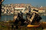 Decaying fishing boats lie by the Rio Douro's banks opposite the Episcopal Palace and Se,or Cathedral. Stock Photo - Premium Rights-Managed, Artist: AWL Images, Code: 862-03437321
