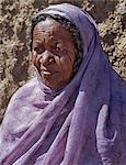 Nubian women wear bright dresses and headscarves even though they are Muslims. Many of the older generation have tribal scars on their faces. .