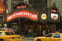 restaurant new york manhattan - New York City cabs pass in front of the Hard Rock Cafe at Times Square Stock Photo - Premium Rights-Managednull, Code: 862-03437427